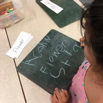 Manar working hard on her see and write! Acorn, Flower, Sticks!