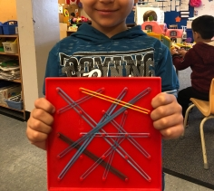 Saad had fun at the geoboard station!